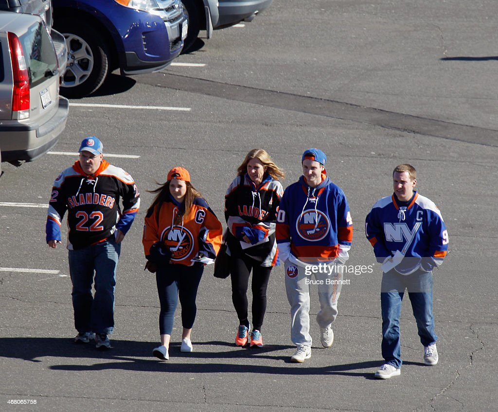 New York Islanders fans arrive for the game against the Detroit Red Wings at the Nassau Veterans Memorial Coliseum on March 29, 2015 in Uniondale, New York. The Islanders defeated the Red Wings 5-4.