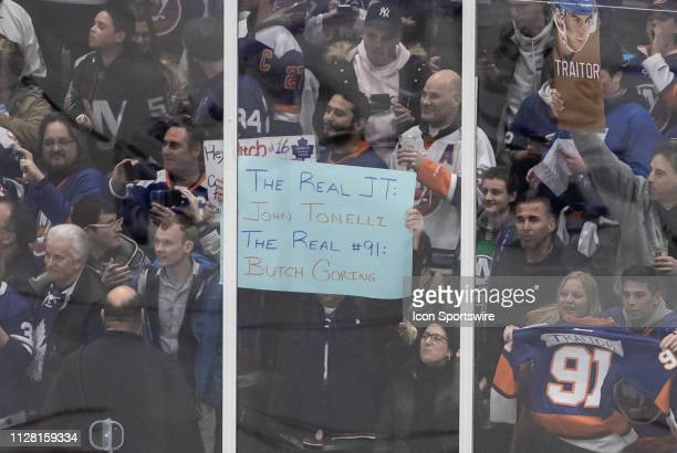 New York Islanders fans share their thoughts on Toronto Maple Leafs Center John Tavares no longer being with the team before a game between the New...