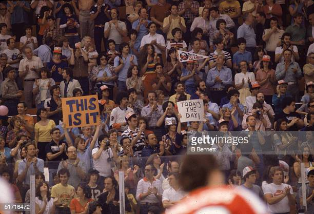 New York Islanders fans stand and clap in anticipation of the Islanders winning their first ever Stanley Cup, Nassau Coliseum, Uniondale, Long...