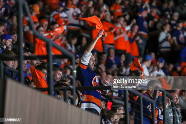 New York Islanders fans stay energetic late into the third period of game 2 of the first round of the Stanley Cup Playoffs between the New York...
