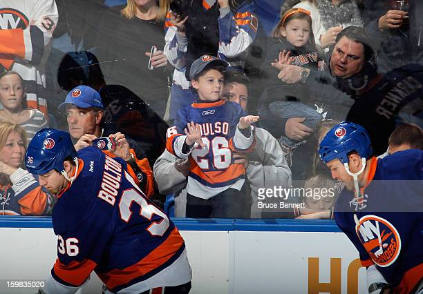New York Islanders fans watch warmups prior to the game against the Tampa Bay Lightning at the Nassau Veterans Memorial Coliseum on January 21, 2013...