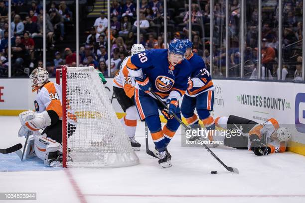 New York Islanders Forward Kieffer Bellows gets ready to attempt a wrap around on Philadelphia Flyers Goaltender Alex Lyon after breaking free from...