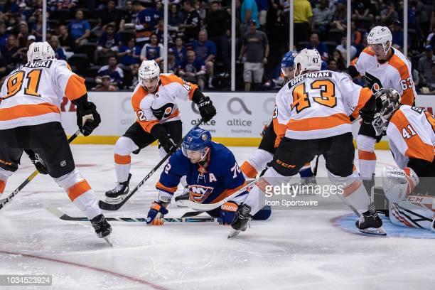 New York Islanders Forward Stephen Gionta is swarmed by Philadelphia Flyers players TJ Brennan , Carsen Twarynski , Cole Bardreau and German Rubtsov...