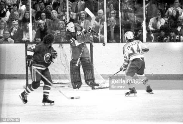 New York Islanders' goalie Billy Smith comes off the ice to block a goal attempt by St Louis Blues Doug Palazzari in the first period of the game