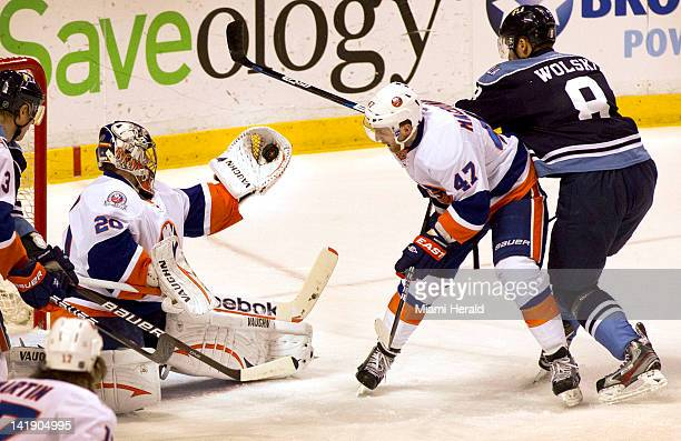 New York Islanders goalie Evgeni Mabokov makes a glove save against the Florida Panthers in the first period at the BankUnited Center in Sunrise...
