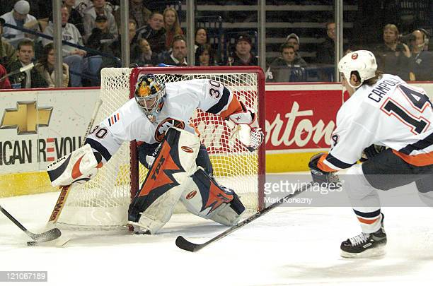 New York Islanders goalie Garth Snow makes a save in a game at HSBC Arena in Buffalo, New York on December 26, 2005. Buffalo won the game 6-3.