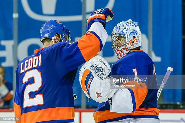 New York Islanders Goalie Thomas Greiss is congratulated for winning by New York Islanders Defenceman Nick Leddy after the Toronto Maple Leafs and...
