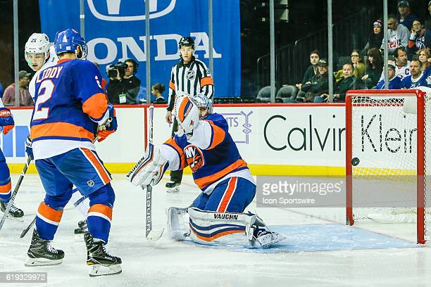 New York Islanders Goalie Thomas Greiss misses save on shot by Toronto Maple Leafs Defenseman Jake Gardiner during the Toronto Maple Leafs and New...
