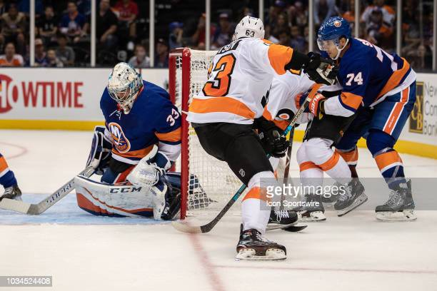 New York Islanders Goaltender Christopher Gibson makes a save on the betweenthelegs attempt of Philadelphia Flyers Forward German Rubtsov as...