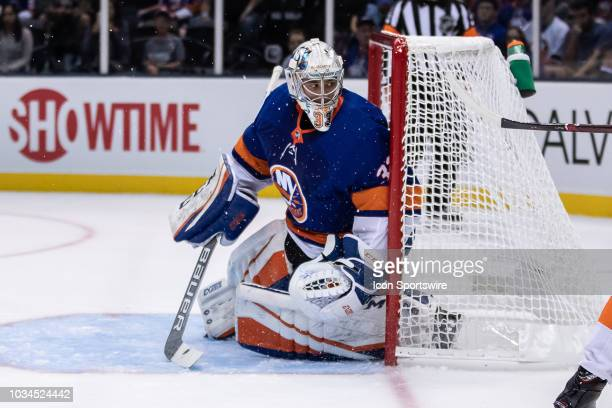 New York Islanders Goaltender Christopher Gibson watches the puck during a preseason game against the New York Islanders on September 16 at the NYCB...