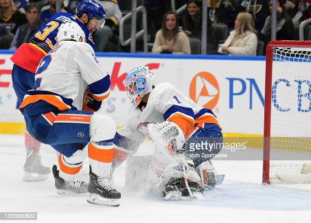 New York Islanders goaltender Thomas Greiss blocks a shot on goal by St Louis Blues center Jordan Kyrou during an NHL game between the New York...