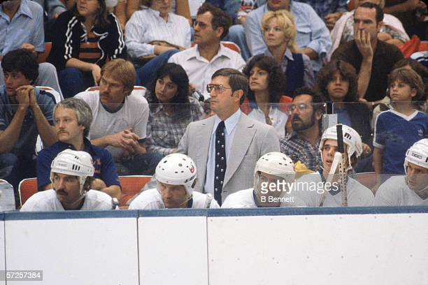 New York Islanders' head coach Al Arbour equipment manager Jim Pickard and players watch a game from the bench at Nassau Coliseum Uniondale Long...