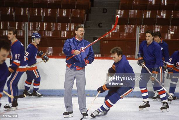New York Islanders head coach Al Arbour gestures with a hockey stick during team practice for an upcoming game against the Montreal Canadiens at the...