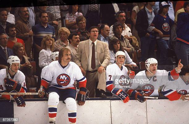New York Islanders head coach Al Arbour stands on the bench to watch a home game at Nassau Coliseum Uniondale Long Island New York May 1982 Arbour is...
