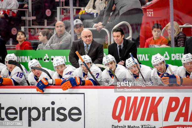 New York Islanders head coach Barry Trotz and the bench watch play during the Detroit Red Wings game versus the New York Islanders on March 16 at...