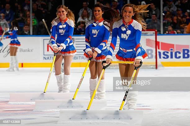 New York Islanders ice girls skate during the game between the New York Islanders and the Dallas Stars at Nassau Veterans Memorial Coliseum on...
