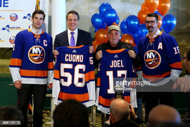 New York Islanders John Tavares Governor of New York Andrew Cuomo Musician Billy Joel and New York Islanders Cal Clutterbuck pose for a photo at Turf...
