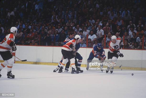 New York Islanders' John Tonelli defends against the Philadelphia Flyers' Paul Holmgren during a game at the Spectrum circa 1980 in Philadelphia...