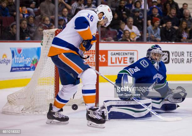 New York Islanders Left Wing Andrew Ladd attempts to control the rebound in front of Vancouver Canucks Goalie Ryan Miller during a NHL hockey game on...