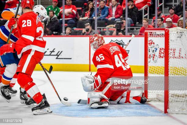 New York Islanders left wing Andrew Ladd can't quite get his stick on the puck in front of Detroit Red Wings goaltender Jonathan Bernier during the...