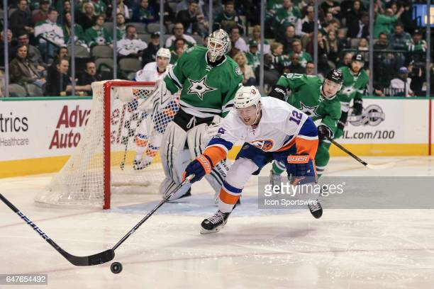 New York Islanders left wing Josh Bailey reaches for the puck with his stick in front of Dallas Stars goalie Antti Niemi during the game between the...