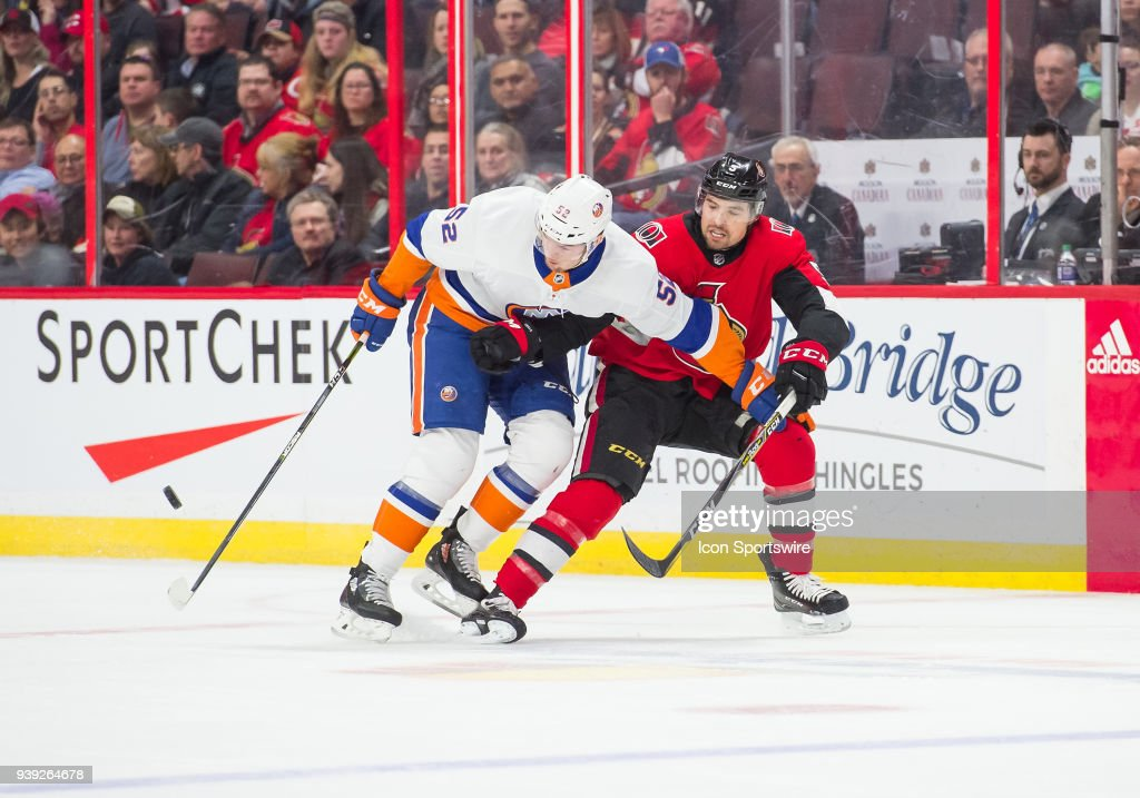 New York Islanders Left Wing Ross Johnston (52) stickhandles the puck against Ottawa Senators Defenceman Cody Ceci (5) during the first period of the NHL game between the Ottawa Senators and the New York Islanders on March 27, 2018 at the Canadian Tire Centre in Ottawa, Ontario, Canada.