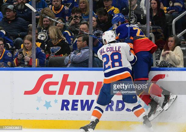 New York Islanders leftwing Michael Dal Colle checks St Louis Blues defenseman Alex Petrangelo into the boards during an NHL game between the New...