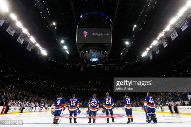 New York Islanders look on during a moment of silence for the late CoOwnwer Charles B Wang prior to the game against the Florida Panthers at Barclays...
