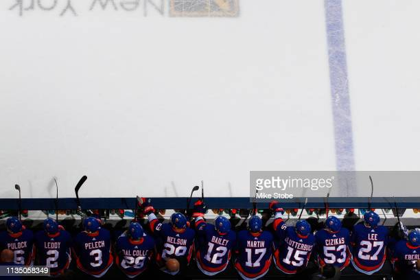 New York Islanders look on from the bench against the Buffalo Sabres at NYCB Live's Nassau Coliseum on March 30, 2019 in Uniondale, New York. New...
