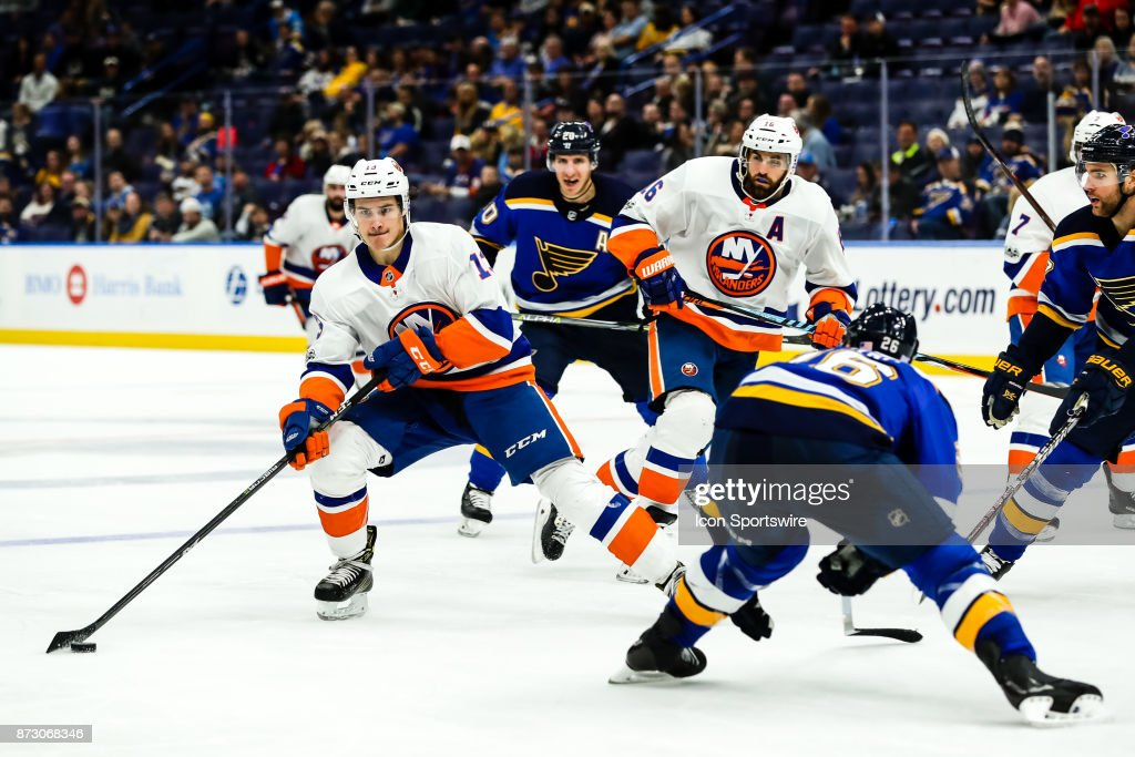 New York Islanders' Mathew Barzal, left, makes a move with the puck in front of St. Louis Blues' Paul Stastny, right, during the third period of an NHL hockey game. The New York Islanders defeated the St. Louis Blues 5-2 on November 11, 2017, at Scottrade Center in St. Louis, MO.