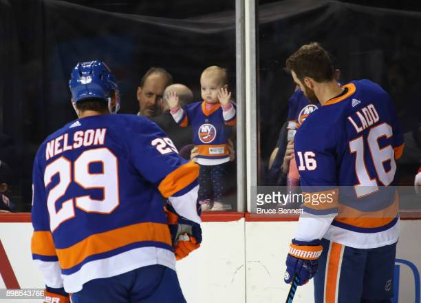New York Islanders players skate in warmups past players children prior to the game against the Winnipeg Jets at the Barclays Center on December 23...