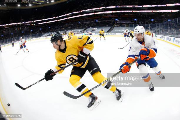 New York Islanders right wing Jordan Eberle chases after ]Boston Bruins center Charlie Coyle along the boards during a game between the Boston Bruins...