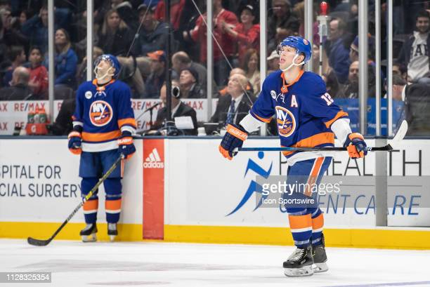 New York Islanders Right Wing Josh Bailey and New York Islanders Right Wing Jordan Eberle look to the rafters in disbelief as a missed pass ended up...