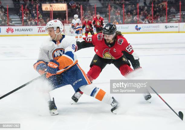 New York Islanders Right Wing Tanner Fritz and Ottawa Senators Defenceman Erik Karlsson battle for the puck during the third period of the NHL game...