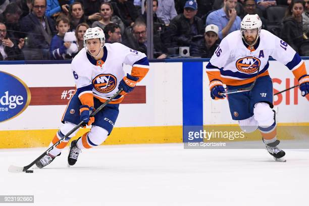 New York Islanders Right Wing Tanner Fritz carries the puck as Left Wing Andrew Ladd follows the play during the regular season NHL game between the...