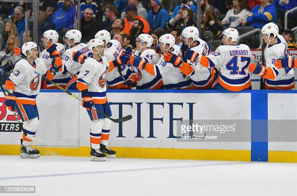 New York Islanders rightwing Jordan Eberle is congratulated by his teammates after scoring in the first period during an NHL game between the New...