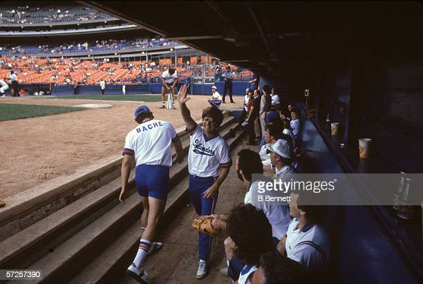 New York Islanders trainer Ron Waske high fives Islanders forward Clark Gillies during a charity softball match at Shea Stadium Flushing Queens New...