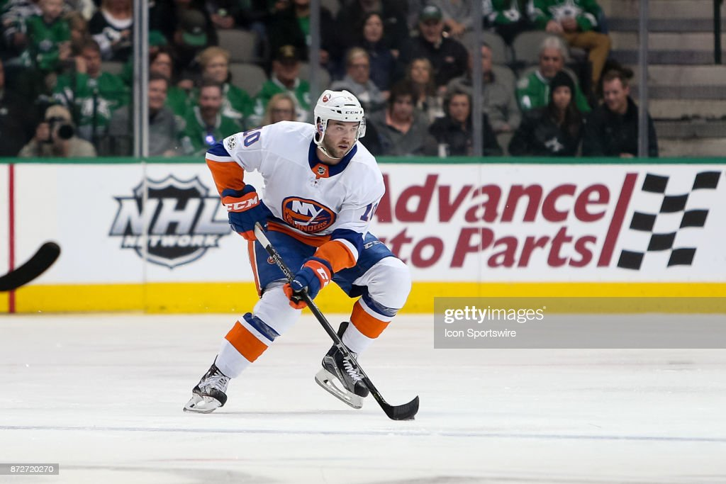 New York Islanders Winger Alan Quine (10) brings the puck up the ice during the NHL hockey game between the New York Islanders and Dallas Stars on November 10, 2017 at American Airlines Center in Dallas, TX.
