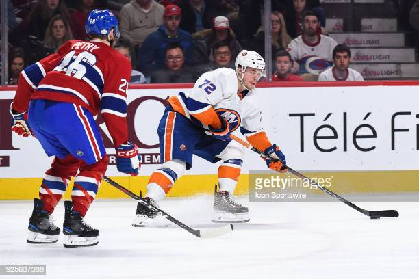 New York Islanders Winger Anthony Beauvillier extends his stick to gain control og the puck during the New York Islanders versus the Montreal...