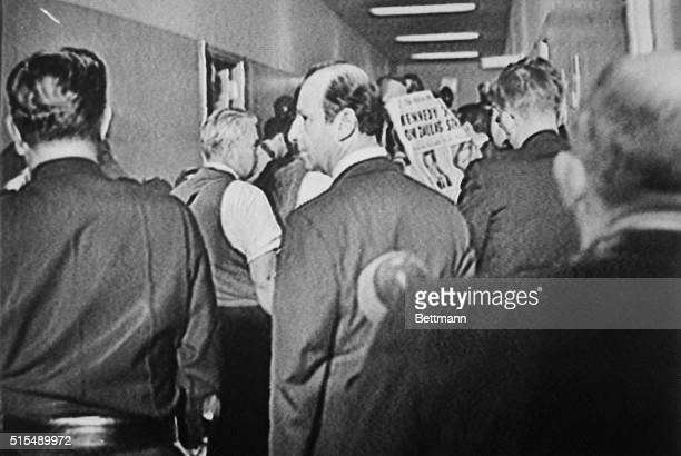 Jack Ruby mingles with the crowd in a corridor at Dallas Police Headquarters on the night of November 22 after President Kennedy's assassination...