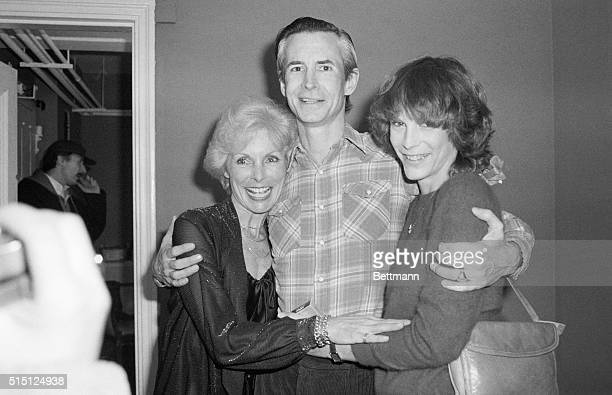 Janet Leigh and her daughter Jamie Lee Curtis flank Tony Perkins backstage at the Barrymore Theater February 19th after watching him in Romantic...
