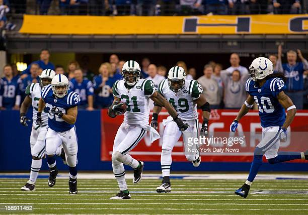 New York Jets against Indianapolis Colts in the AFC WIld Card game at Lucas Oil Stadium Jets cornerback Antonio Cromartie kick off return to give the...