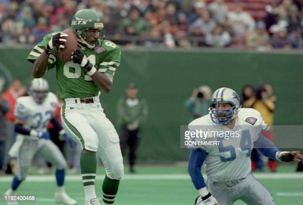 New York Jets Art Monk comes down with a pass from Boomer Esiason in front of Detroit Lions Chris Spielman on the first play of the game 10 December...