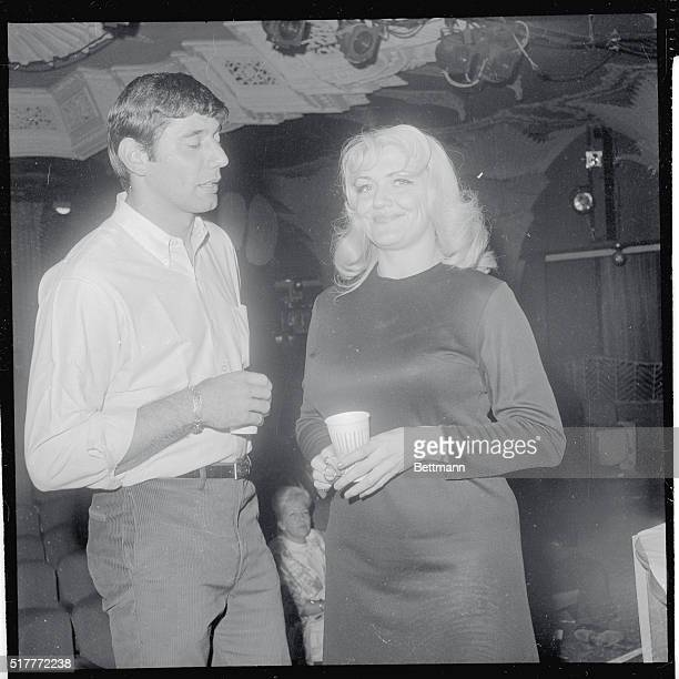 New York Jets backfield star Joe Namath chats with bosomy Jennie Lee who is a star stripper at the Mayfair on West 47th Street off Broadway Namath...