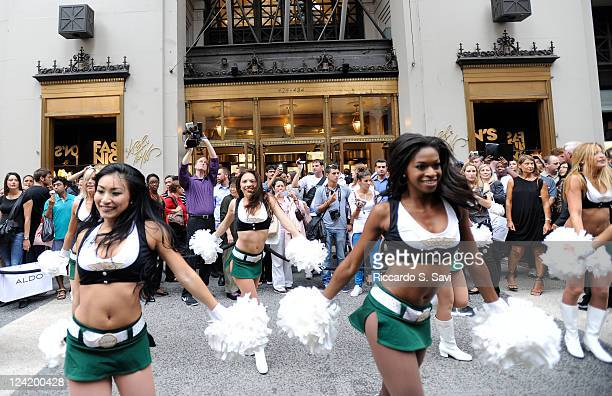 New York Jets Cheerleaders perform at Fashion Night Out at Lord Taylor on September 8 2011 in New York City