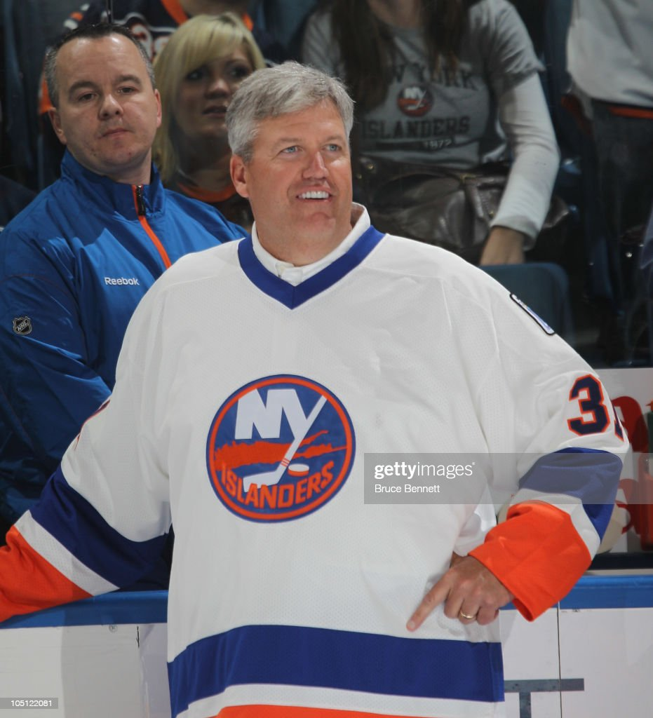 New York Jets coach Rex Ryan gets ready to drop the ceremonial puck between Brenden Morrow #10 of the Dallas Stars and Doug Weight #93 of the New York Islanders prior to the Islanders home opener at the Nassau Coliseum on October 9, 2010 in Uniondale, New York.