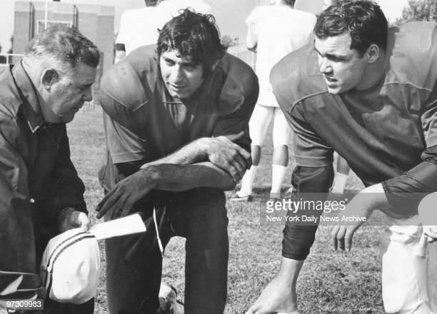 New York Jets' coach Weeb Ewbank Joe Namath and Jim Turner chat together at Rikers Island during a break in the Jets' Practice Session