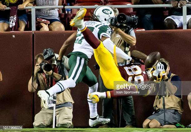 New York Jets cornerback Darryl Roberts crashes into Washington Redskins wide receiver Cam Sims during a NFL preseason game between the Washington...