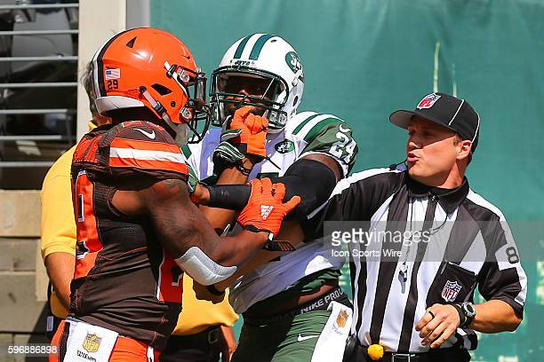 New York Jets defensive back Darrelle Revis gets his facemask grabbed by Cleveland Browns running back Duke Johnson during the second quarter of the...