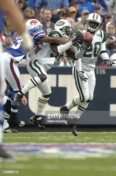 New York Jets defensive backDavid Barrett makes an interception against Buffalo Bills Lee Evans at Ralph Wilson Stadium in Orchard Park, New York,...